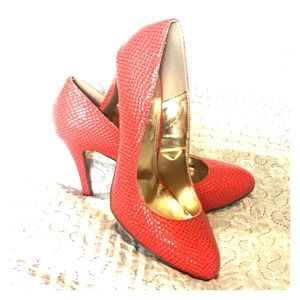 Red snakeskin like heels.